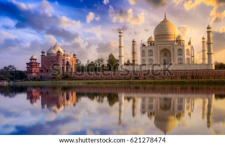 Taj Mahal scenic sunset view with moody sky. A UNESCO World heritage site at Agra, India. Royalty-Free Stock Photo #621278474