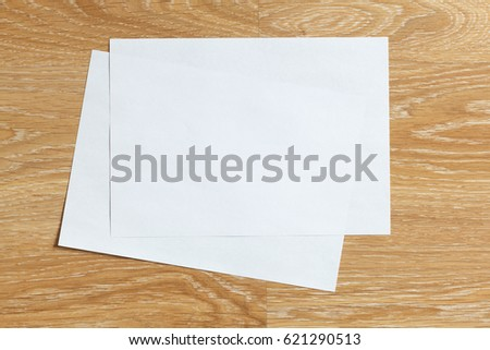Two of blank sheets of paper landscape orientation on wooden background #621290513