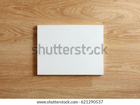 Blank canvas with landscape orientation on wooden wall #621290537