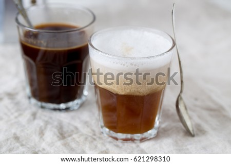 Hot latte and black coffee on white background. Morning concept #621298310