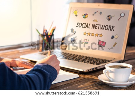 Social Network Concept On Work Desk With Various Hand Drawn Doodle Icons On Laptop Screen #621358691