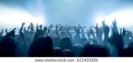cheering crowd at a rock concert #621403286