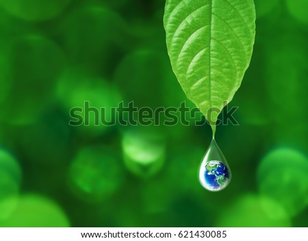 Earth in water drop reflection under green leaf, water and environment concept, Elements of this image furnished by NASA Royalty-Free Stock Photo #621430085