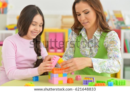 Mom and daughter have fun playing  #621648833