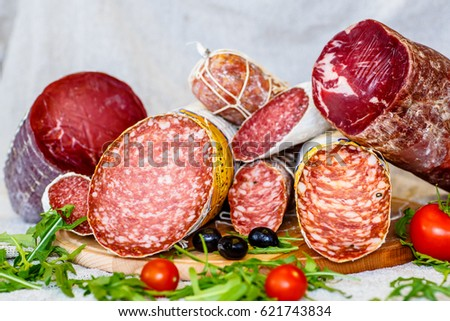 Various Italian sausages lying on the counter #621743834