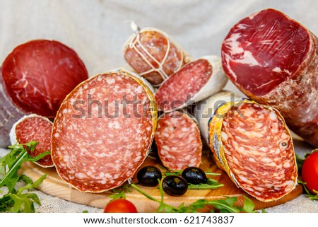 Various Italian sausages lying on the counter #621743837