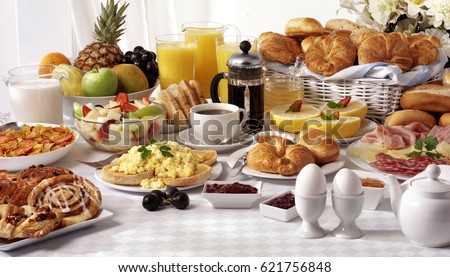 BREAKFAST BUFFET TABLE FILLED WITH ASSORTED FOODS,SAVOURY,SWEET,PASTRIES,HOT AND COLD DRINKS #621756848