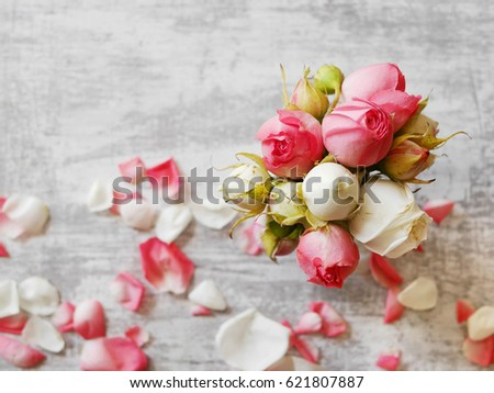 Bouquet of small roses on a background of bleached board.  Top view, flat lay. Flowers, spring, summer concept. March 8, mother's day background. #621807887