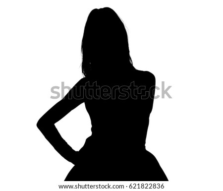 Silhouette of a young female model posing in a wide dress. #621822836