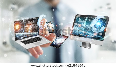 Businessman on blurred background connecting tech devices 3D rendering #621848645