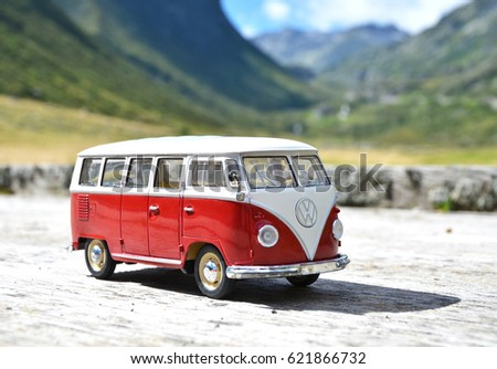 SOUTH TYROL, ITALY - JULY 27, 2016: Miniature VW Bulli 1962 on the rural road. The cult car of the Hippie generation and it remained the status vehicle of campers. #621866732