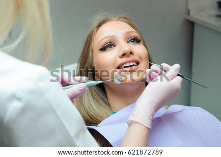 dentistry, patient examination and treatment at the dentist #621872789