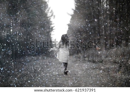 young woman in a trench coat walks in autumn park #621937391