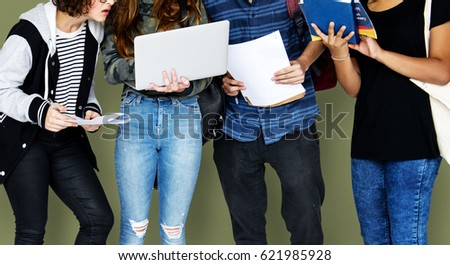 Group of Diverse High School Students Using Digital Devices Studio Portrait #621985928