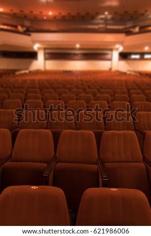 red velvet seats for spectators in the theater or cinema #621986006