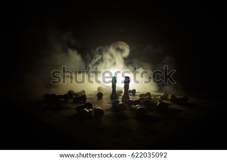 chess board game concept of business ideas and competition and strategy ideas concep. Chess figures on a dark background with smoke and fog. Selective focus #622035092