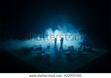 chess board game concept of business ideas and competition and strategy ideas concep. Chess figures on a dark background with smoke and fog. Selective focus #622035101