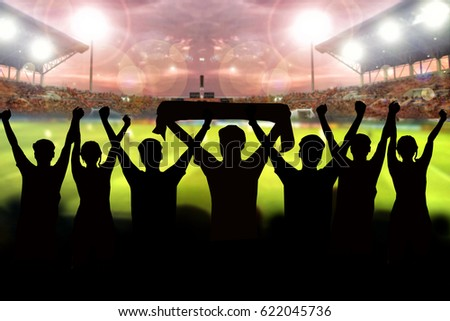 silhouettes of Soccer fans in a match and Spectators at football stadium #622045736