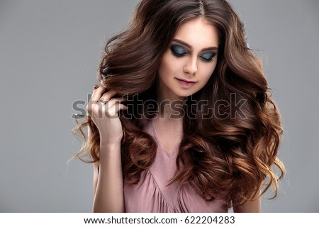 closeup beauty portrait of young woman with fashion makeup and brown curls hairstyle. spa and care. #622204283