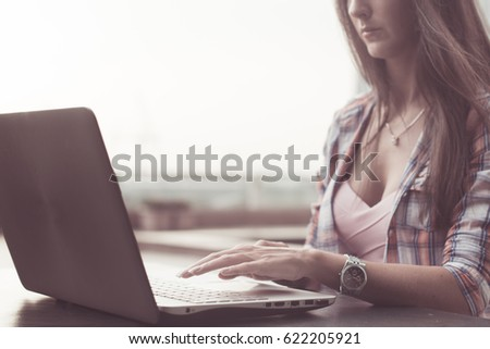 Close up shot of female hands typing on a laptop keyboard. #622205921