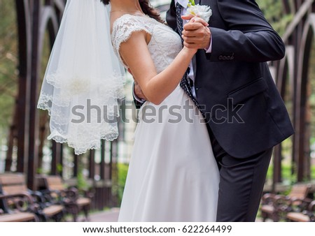 Bride and groom standing together in the park  #622264499