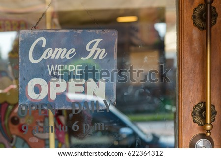 Open sign broad through the glass of door at coffee shop #622364312