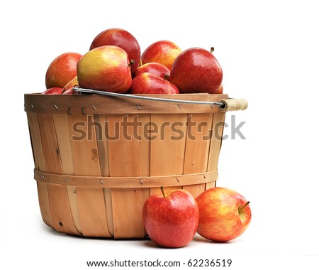Apples in a wooden basket on white #62236519