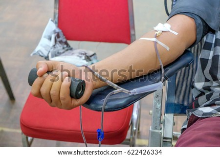 Blood donor at donation with a bouncy holding in hand. #622426334