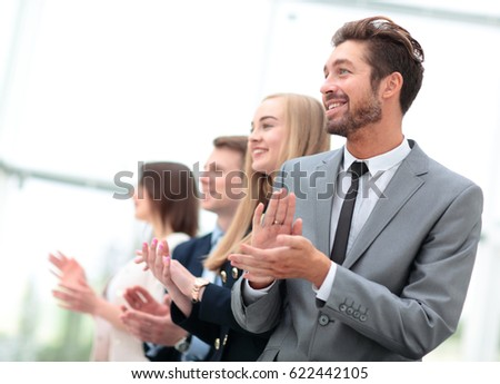 Business people standing in a row looking in same direction and  #622442105