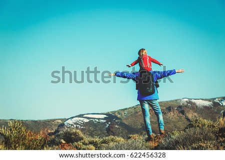 father with little daughter hiking in mountains #622456328