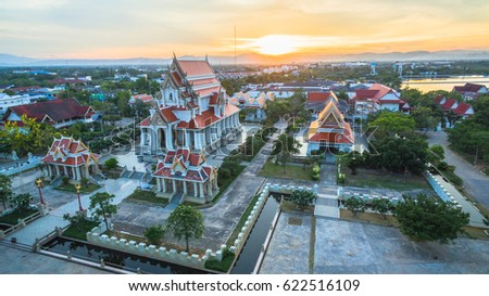 aerial photography during sunset at the beautiful palace on hilltop beside the ocean in Prajuab kirikhan #622516109