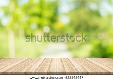 Emply table top on blurred nature background,Space for placing products #622542467
