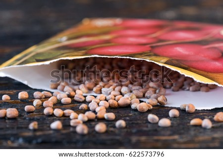 Radish Seeds Spilled from a Seed Packet Royalty-Free Stock Photo #622573796
