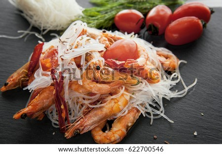 cellophane boiled with grilled shrimp and spices and tomatoes #622700546