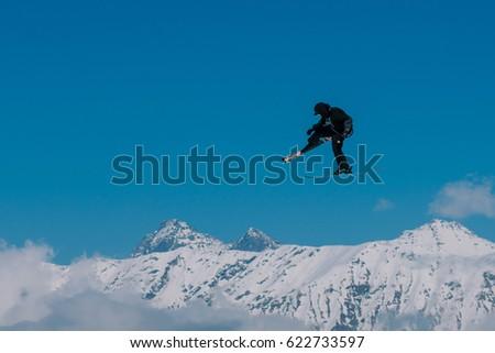 2017 04 Sochi, Russia, Festival NewStarCamp: skier jumps from a high springboard #622733597