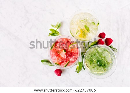 Fruit summer drinks with ice. Flat lay, top view. Royalty-Free Stock Photo #622757006