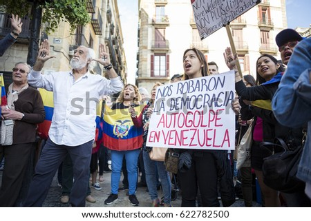 BARCELONA, SPAIN - APRIL 2017 - Venezuelan people prortest in Barcelona against Venezuelan Politicians on April 15, 2017 in Saint James's Square, Barcelona, Spain. #622782500