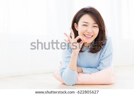 young attractive asian woman relaxing #622805627