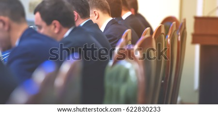 Conference room or seminar meeting room in business event. Session of Government. Academic classroom training course in lecture hall. blur abstract background. working in modern bright office indoor Royalty-Free Stock Photo #622830233