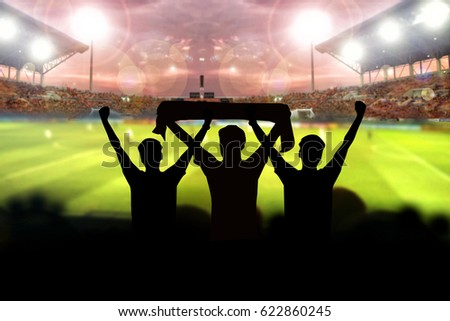silhouettes of Soccer fans in a match and Spectators at football stadium #622860245