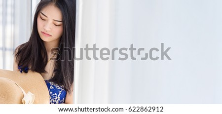 cute asian gril with summer dress and hat with relaxing pose with white room background #622862912