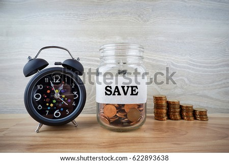 Coins in glass jar for money save financial concept with time management                                #622893638