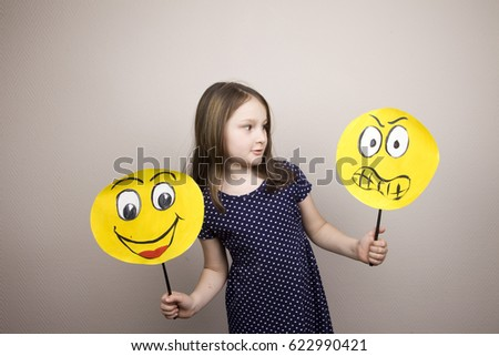 Development of emotional intelligence. The girl plays with smiles, builds erysipelas. Laughter, fun, anger. Teaching a child. #622990421