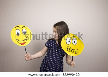 Development of emotional intelligence. The girl plays with smiles, builds erysipelas. Laughter, fun, anger. Teaching a child. #622990430