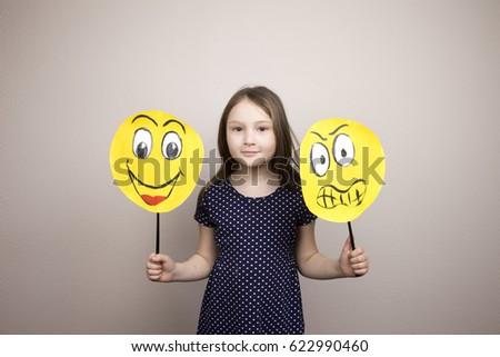 Development of emotional intelligence. The girl plays with smiles, builds erysipelas. Laughter, fun, anger. Teaching a child. #622990460