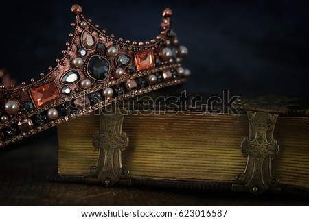 low key image of beautiful queen/king crown on old book. vintage filtered. fantasy medieval period #623016587