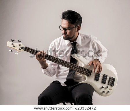 portrait of asian businessman playing guitar on the chair #623332472