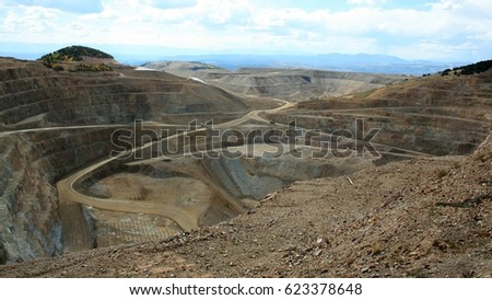 Spectacular afternoon viewpoint of open pit gold mining in Colorado, USA #623378648