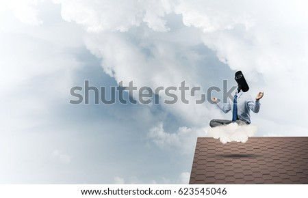 Faceless businessman with camera zoom instead of head sitting in lotus pose #623545046