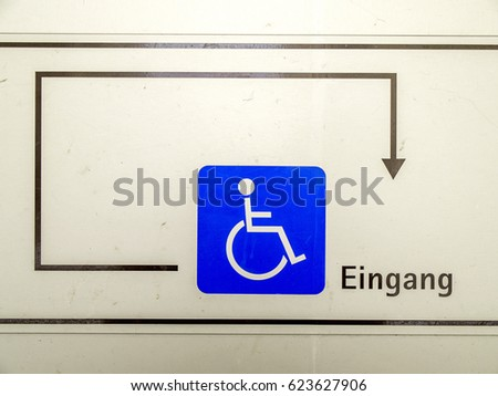 Direction sign to the entrance for disabled people #623627906